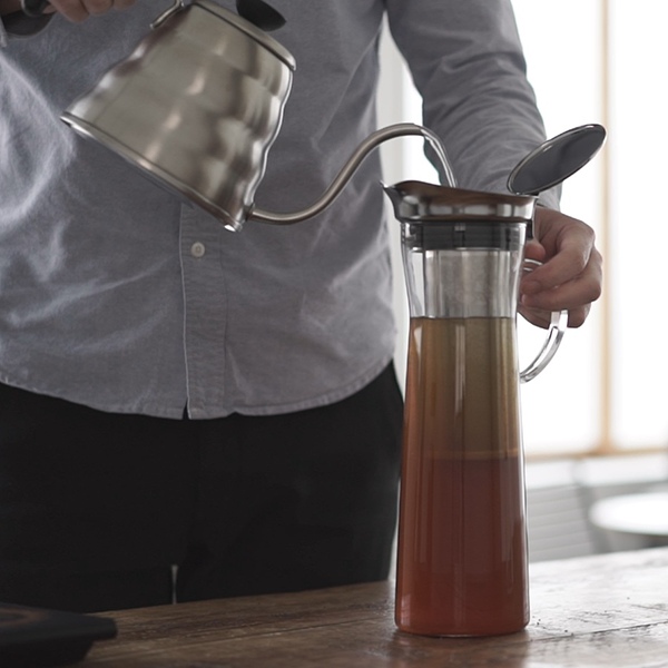 Just coffee grounds and water are needed. A large amount of ice cubes are not required.